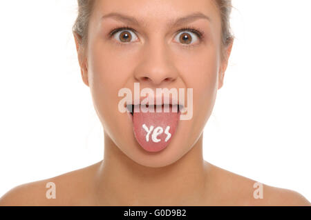 Woman puts out the tongue with an inscription yes - Stock Photo