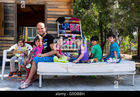 Syrian refugee father and six children given shelter in a refugee camp on the island of Lesvos after crossing from - Stock Photo