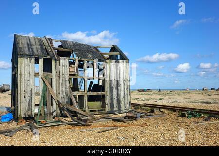 Old Abandoned fisherman's hut on Dungeness shingle beach Kent England UK - Stock Photo