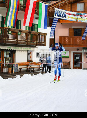 Skiers take part in the Marcialonga, an annual cross country skiing race in the Italian Dolomites. - Stock Photo