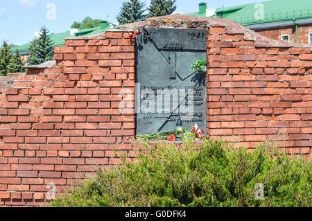 Brest, Belarus - May 9, 2015: The memorial plaque in the Brest Fortress. The translation is 'On 03 March 1918, a - Stock Photo
