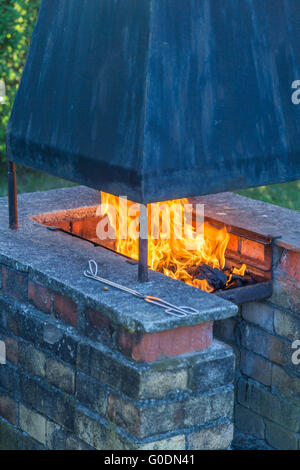 Garden fireplace and barbecue - Stock Photo