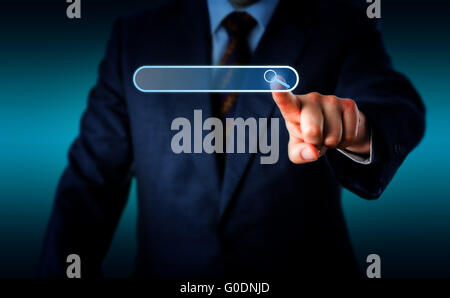 Businessman Touching Magnifier Icon In Search Box - Stock Photo