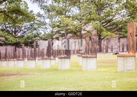 The Oklahoma Bombing Monument with empty chair sculptures that memorialize those lost to the terrorist bombing - Stock Photo