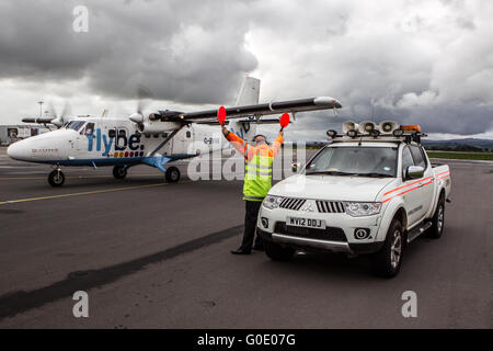 Fly Be Plane being guided in by flight traffic controller - Stock Photo