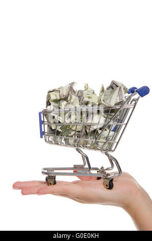 crumpled dollars in shopping trolley on the palm - Stock Photo
