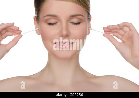 charming woman cleans ears with cotton sticks - Stock Photo