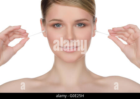 beautiful woman cleans ears with cotton sticks - Stock Photo
