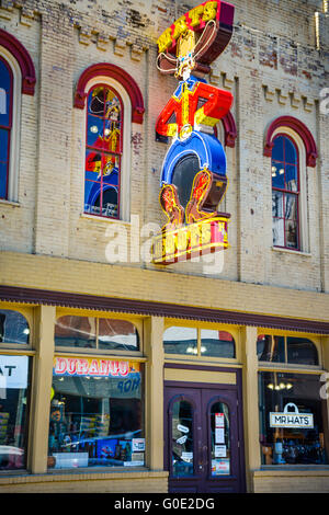 Mr. Hat's iconic, colorful Neon Cowboy sign, advertises boots and hats, a landmark on 3rd Ave So., Nashville, TN, Music City USA
