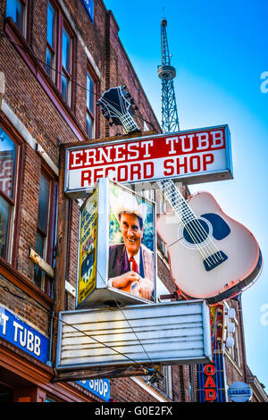 The world renowned Ernest Tubb Record Shop has rotating photos and neon guitar outside the old brick store in Nashville, - Stock Photo