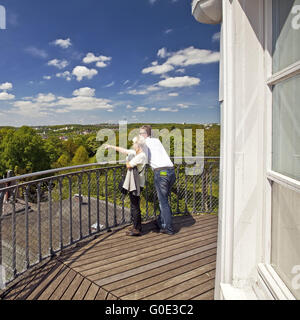couple admiring the view from the Elisen Tower - Stock Photo