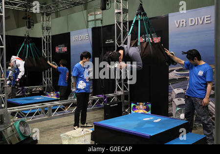Chiba, Japan. 30th Apr, 2016. A visitor, hanged in the air by wire, enjoys virtual sky diving with headmount during the Niconico Chokaigi in Chiba on Saturday, April 30, 2016. Some 150,000 visitors enjoyed over 100 booths including games, hobbies, sports, politics as well as Japan's sub cultures at the two-day offline meeting sponsored by Japan's video sharing website 'Niconico Douga'. © Yoshio Tsunoda/AFLO/Alamy Live News
