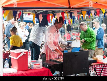 Man cooking food at Lyttelton Farmer's Market, Lyttelton, Lyttelton Harbour, Banks Peninsula, Canterbury, New Zealand - Stock Photo