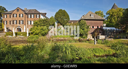 river Schwalm with mill and castle in Brueggen - Stock Photo