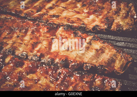 Pork Ribs on the Grill with Retro Instagram Style Filter - Stock Photo