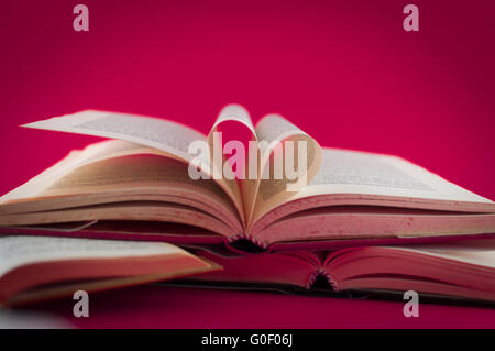 books open on colored background - Stock Photo