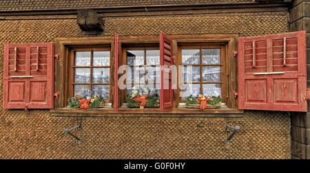 Chalet with shutters red - Stock Photo