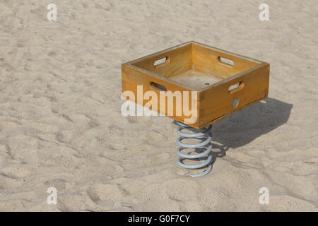 childrens toy on outdoor payground in sandpit - Stock Photo