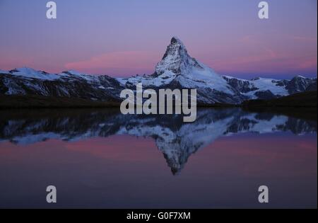 Pink morning sky over the Matterhorn - Stock Photo