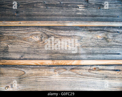 Wood Background Texture. Rustic weathered barn wood background with knots and scratches - Stock Photo