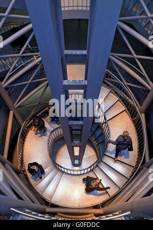 Four people on the stairs at Reinoldikirche Metro Station, Dortmund, Germany - Stock Photo