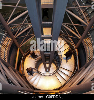 Three people on the stairs at Reinoldikirche Metro Station, Dortmund, Germany - Stock Photo