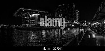 Black white night panoramic view on Jazz Hall and harbour in Amsterdam - Stock Photo