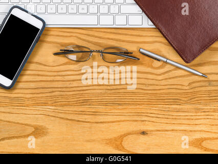 Desktop with basic items for working in office - Stock Photo