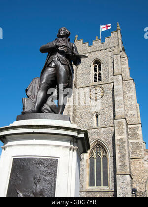 A statue of the artist Thomas Gainsborough outside St Peter's Church in Sudbury, Suffolk, England. - Stock Photo