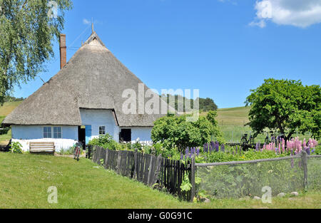 historic House with thatched Roof in Gross Zicker on Ruegen Island,baltic Sea,Germany - Stock Photo