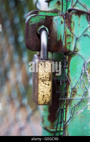 Padlock on rusty gate - Stock Photo