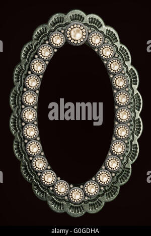 metal oval frame decorated with a pattern of pearls - Stock Photo