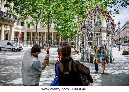 Family visiting Paris and taking photos - Stock Photo