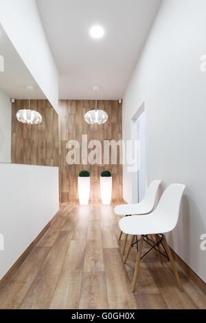 Modern waiting room, reception. Cozy minimalistic interior - Stock Photo