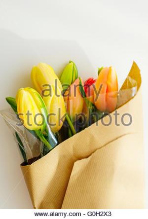 Tulip flowers bouquet warped in paper - Stock Photo