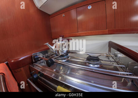 Kettle on gas  stove on yacht - Stock Photo