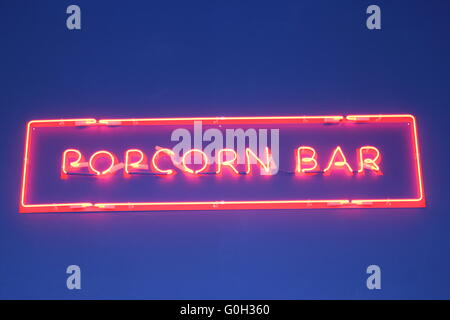 inscription popcorn made from red neon lights - Stock Photo
