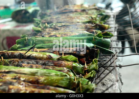 Sticky rice with coconut milk, a banana , taro, banana leaves grilled shrimp filling - Stock Photo
