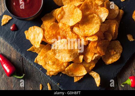 Hot Spicy Sriracha Potato Chips Ready to Eat - Stock Photo