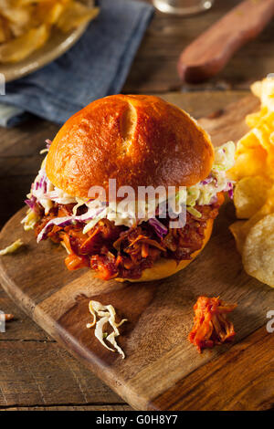 Homemade Vegan Pulled Jackfruit BBQ Sandwich with Coleslaw and Chips - Stock Photo