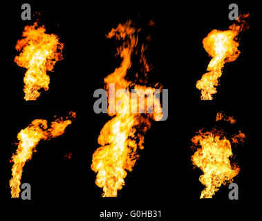 Set of gas flares blazing fire spurts and glowing flames photo set isolated on black background - Stock Photo