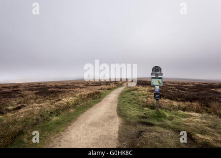 National trust footpath sign on the Pennine way. Path leading onto Bleaklow above Glossop in Derbyshire. - Stock Photo