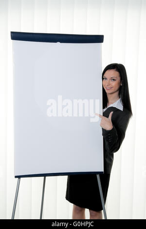 Coach before empty flipchart on education and training - Stock Photo