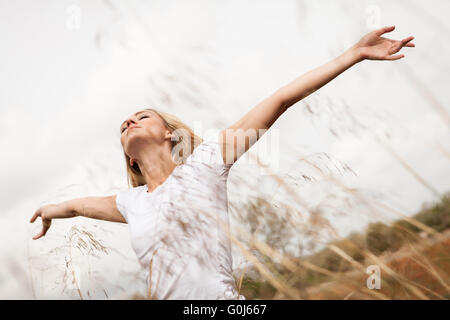 young happy attractive woman arms wide open - Stock Photo