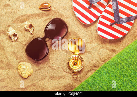 Beach ready, summer holiday vacation accessories on sandy beach, summertime lifestyle objects in flat lay top view - Stock Photo