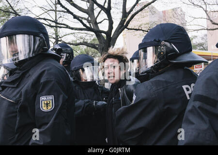 Berlin, Germany. 1st May, 2016. An agnry woman is detained by police during the Revolutionary 1st of May Demonstration - Stock Photo