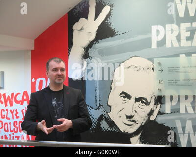 Wroclaw, Poland. 24th Apr, 2016. Museum director Marcin Hamkalo stands in front of graffiti by writer and civil - Stock Photo