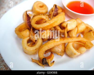 fried calamari appetizer with savory sauce - Stock Photo