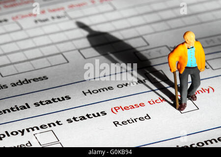 Miniature model pensioner standing on an application form - Stock Photo