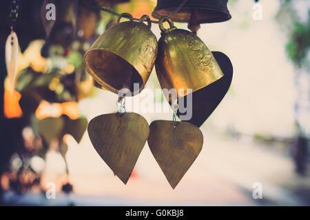 Golden Bells in Buddhist temple of Thailand , Vintage color filter